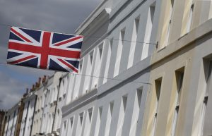 A Union flag hangs across a street of houses in London, Britain in this June 3, 2015 file photo. UK May RICS housing survey data is expected to be released this week. REUTERS/Suzanne Plunkett/Files GLOBAL BUSINESS WEEK AHEAD PACKAGE - SEARCH