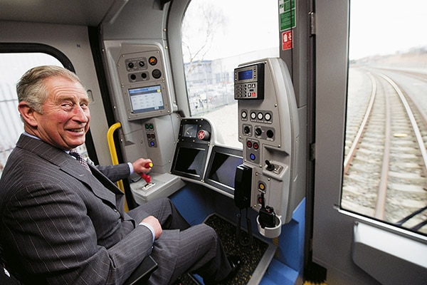 Britain's Prince Charles drives a London Underground tube train built for the Metropolitan line at the Bombardier factory in Derby